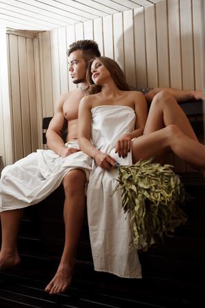 Romantic couple enjoying steam bath at spa centre