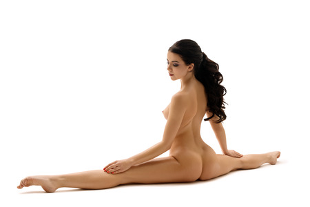 Beautiful brunette in splits nude portrait Stock Photo