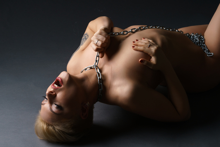nude blonde woman: Woman with metal chain on neck getting orgasm Stock Photo