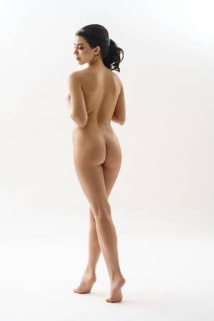 beautiful naked woman: Long haired brunette shot naked view from her back Stock Photo