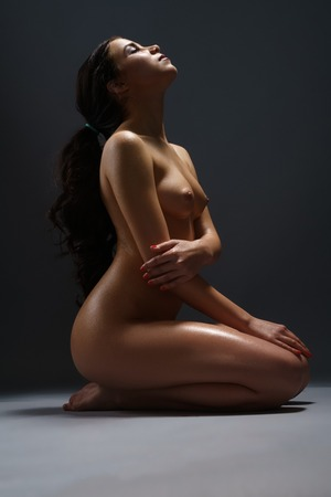 beautiful naked woman: Long haired sunburnt brunette shot naked in studio