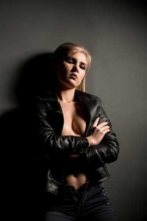 topless jeans: Sexy blonde posing in jacket and jeans