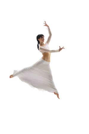Young dancer jumping slenderly in studio Stock Photo