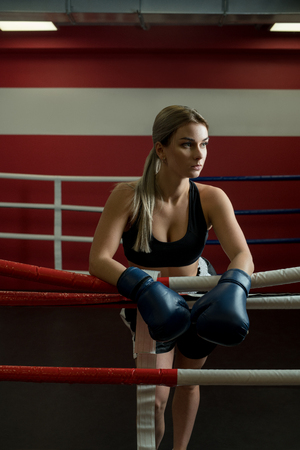 Sexy blonde in boxing gloves portrait