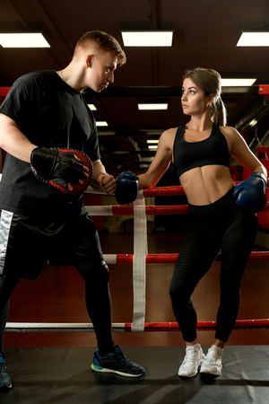 Sexy girl in boxing gloves shot with her boyfriend