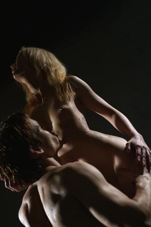 adult sex: Young passionate couple having sex studio shot
