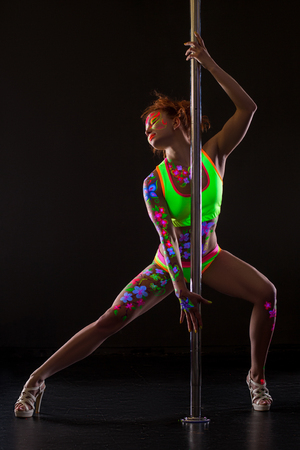 sexy girl dance: Sexy pole dancer with glowing patterns on her body