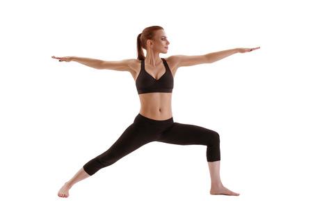Modella fitness esercitando girato in studio Archivio Fotografico