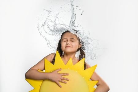 Teenage girl in water stream falling from top Stock Photo