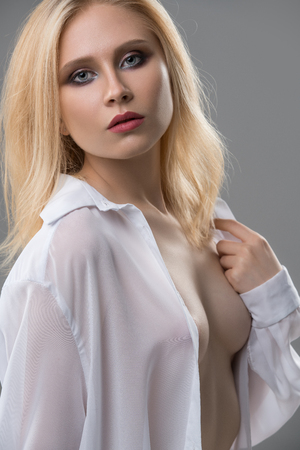 Attractive blonde topless portrait