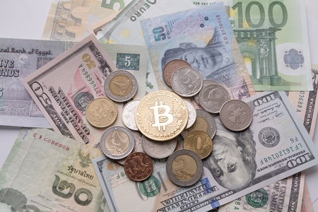 Bitcoin on bills and coins of different countries