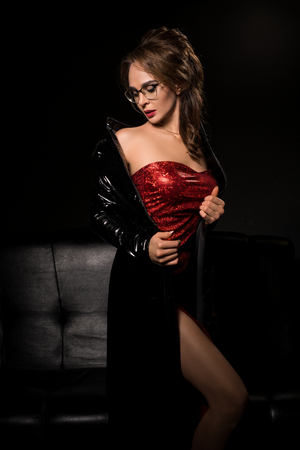 Sexy gorgeous brunette in eyeglasses and red dress