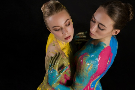 Two nude women with bodyart high angle shot Stock Photo