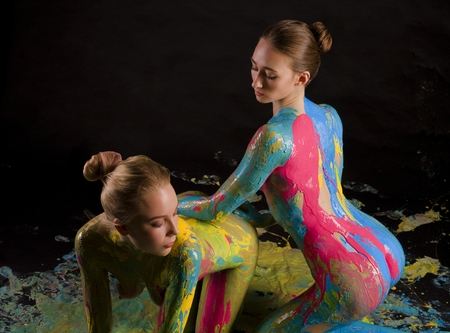 Two girls in the nude with brigth bodyart