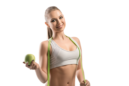 Fitness trainer with an apple and tape-measure