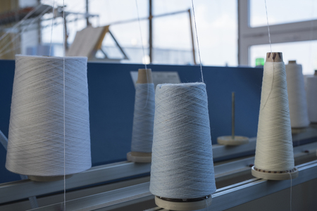 Spools with white thread at knitting shop view 版權商用圖片
