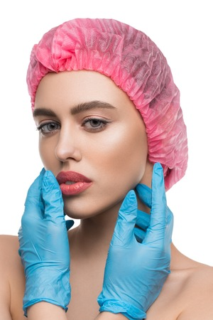 Girl in a pink cap and gloves isolated shot