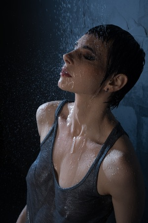 Sexy brunette in wet t-shirt high angle view Stock Photo