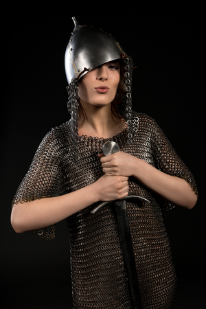 Sexy woman in viking helmet and hauberg with sword Stock Photo