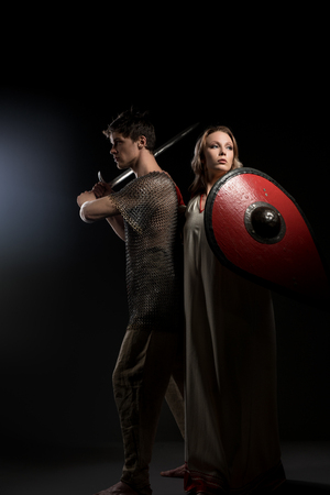 Young viking holding sword and his beautiful wife