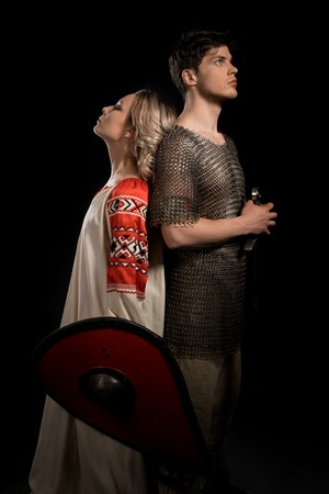 Handsome viking with his beautiful wife shot