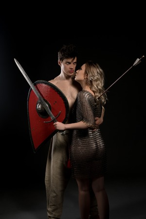 Young viking embracing wife with arrow in her back