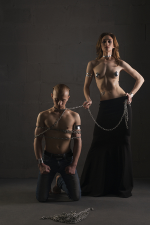Nude couple shot in bdsm style in the dark 스톡 콘텐츠