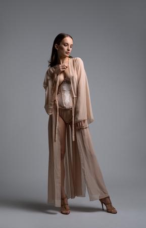 Slim girl in romantic underwear full-length shot