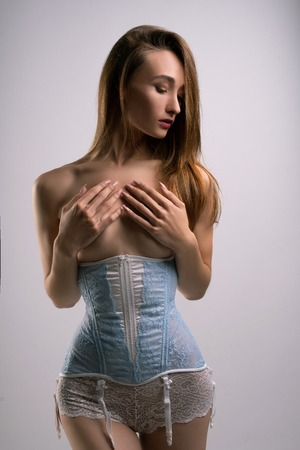Slim blonde in corset and lace shorts