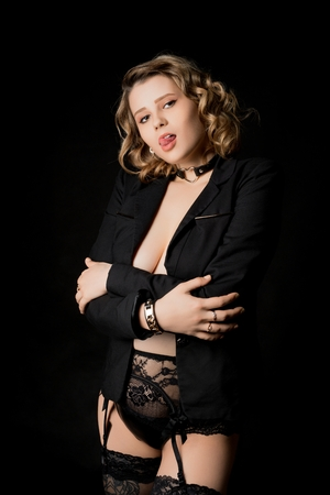 Pretty woman in jacket and stockings shot