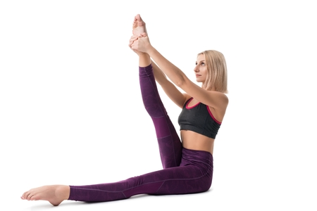 Slim blonde doing yoga isolated view