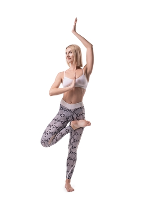 Blonde in a yoga pose isolated shot