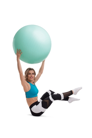 Woman doing fitness with fitball isolated shot