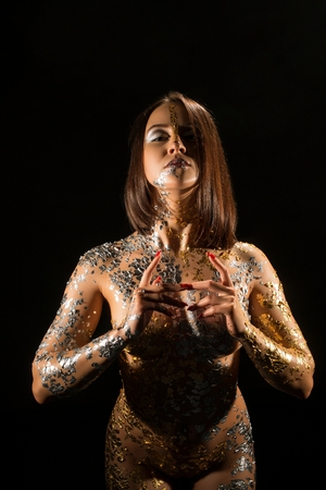 Naked girl with gold bodyart cropped shot 版權商用圖片