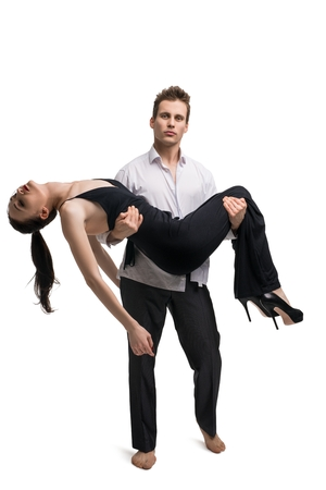 Man carying unconscious girl in his arms Standard-Bild