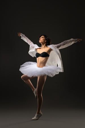 Pretty brunette in ballet tutu dancing