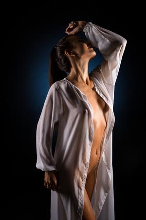 Girl in unbuttoned white shirt view Standard-Bild - 123004621