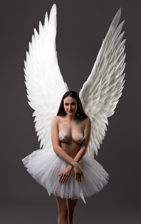 Brunette topless with gorgeous wings view
