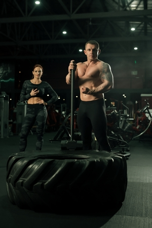 Sporty couple view in a gym