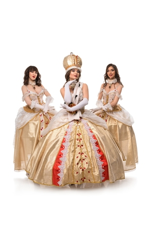 Beautiful models posing in magnificent historical costumes