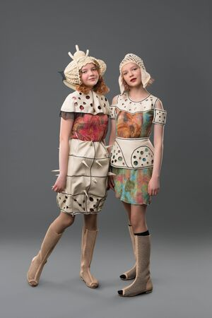 Two girls in colorful dresses and hats portrait