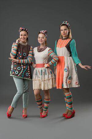 Pretty girls in original folk style dresses view Stock fotó