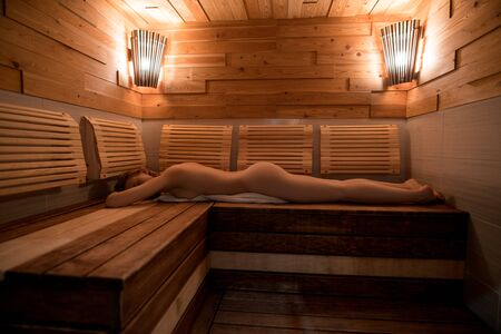 Beautiful nude girl in sauna Banque d'images