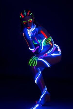 Woman with ultraviolet color pattern bodyart view