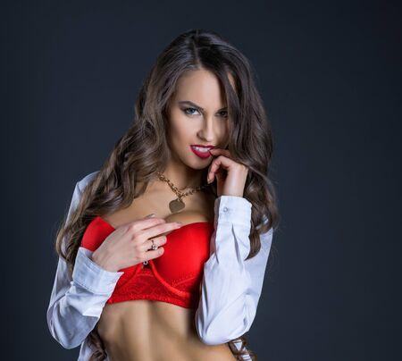 Beautiful tanned model playfully posing at camera Stock fotó