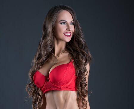 Erotica. Handsome woman posing in lingerie