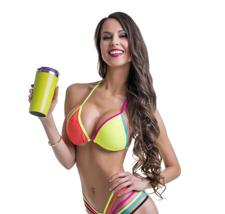 Fitness. Sexy female athlete posing with shaker