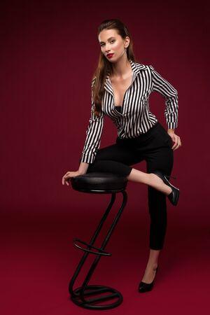 Brunette in sexy shirt portrait near bar stool