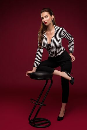 Brunette in shirt portrait near bar stool Foto de archivo