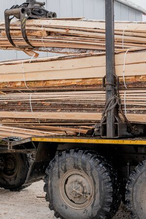 Sawmill. Image of truck transports boards Stock Photo